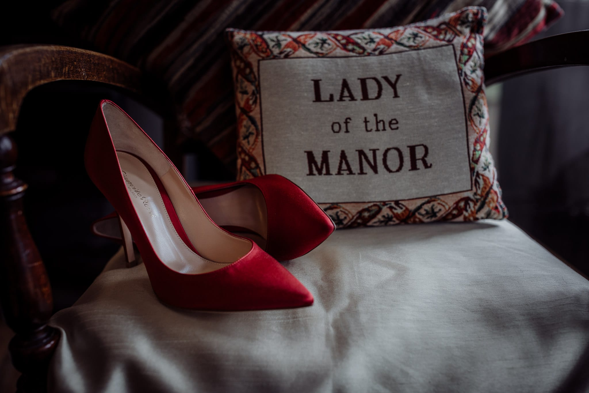 detail photograph of red bridal shoes