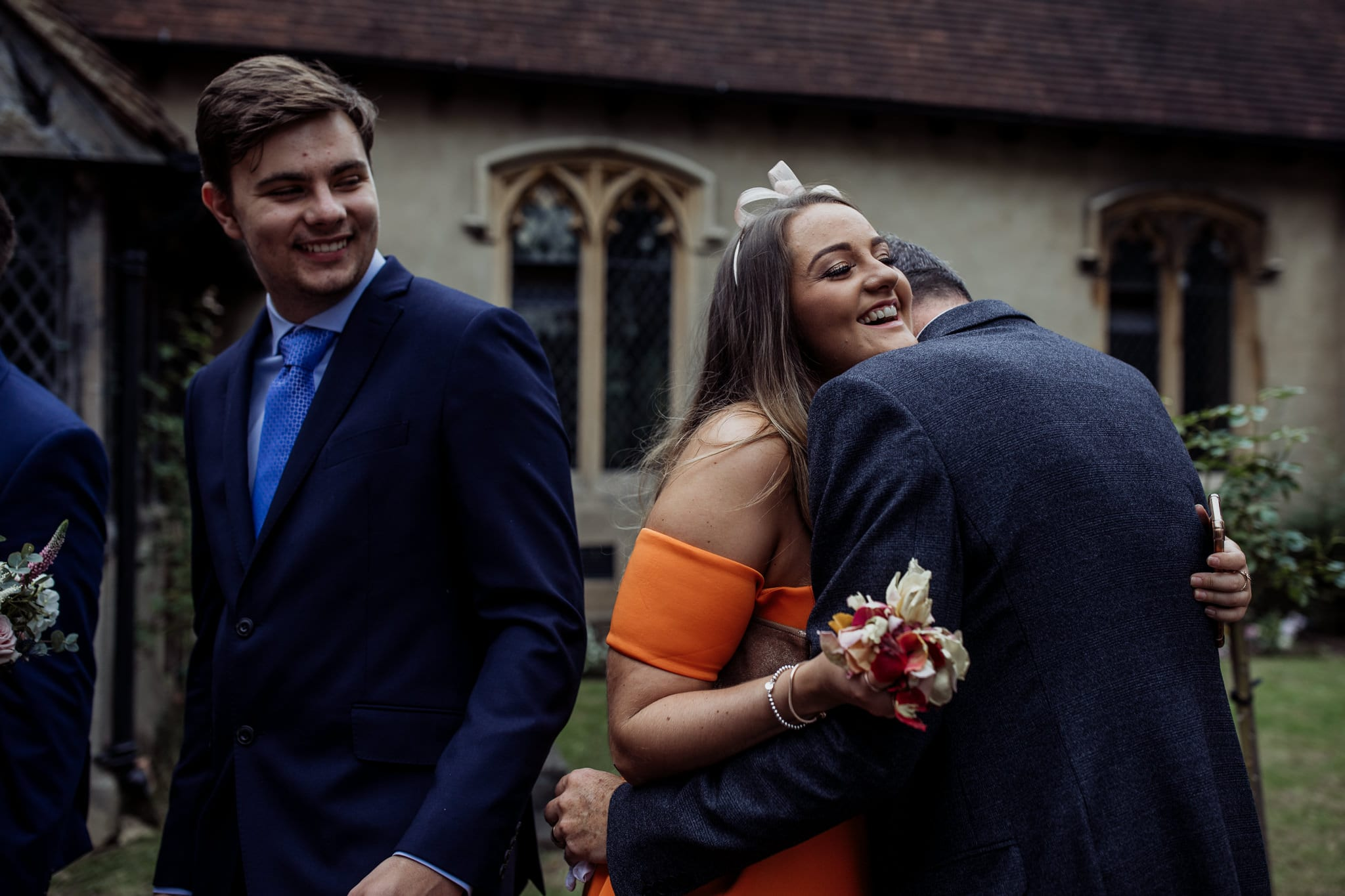wedding guests hugging at an Essex back garden wedding