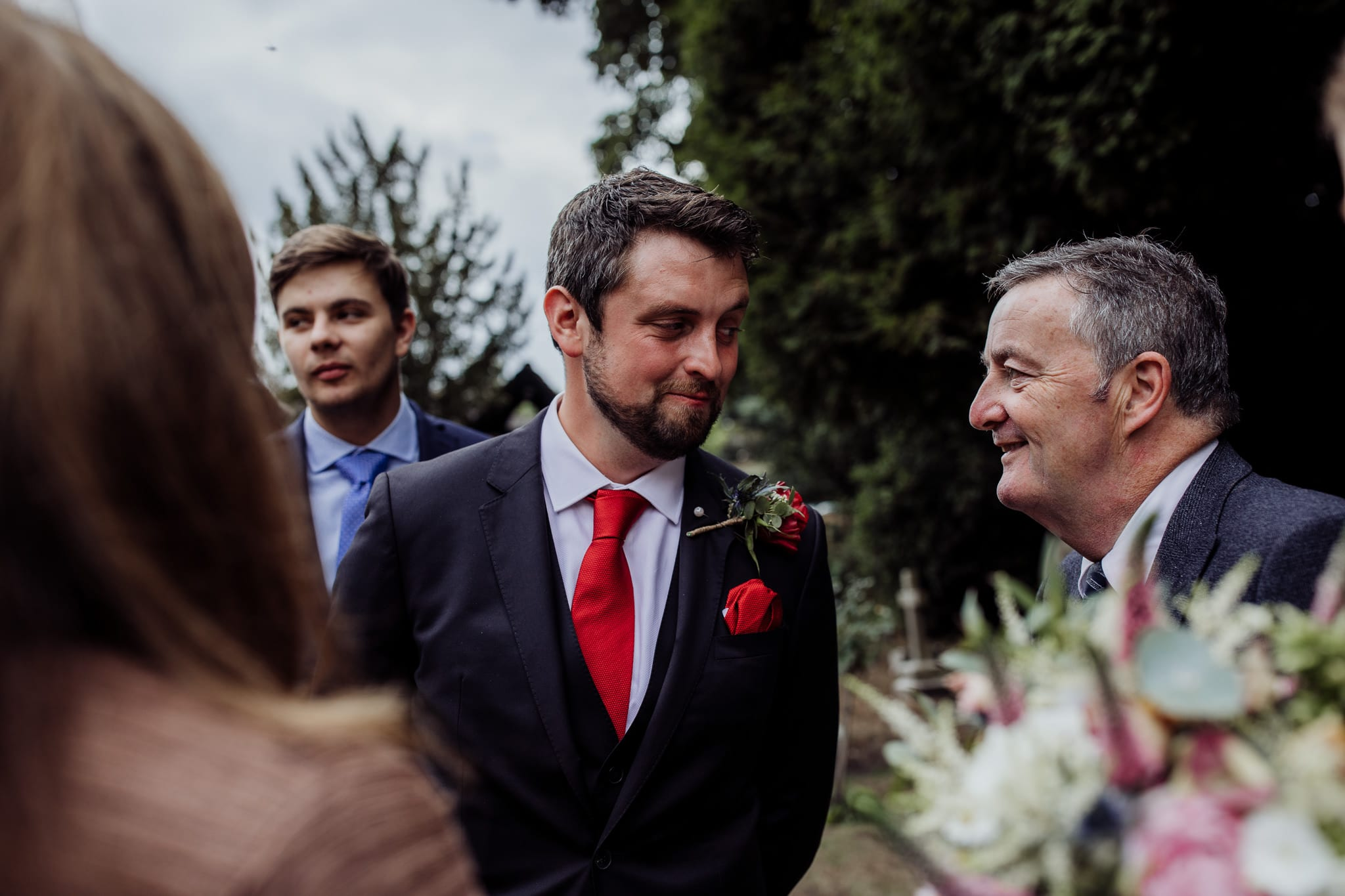 groom and guest talking at an Essex back garden wedding