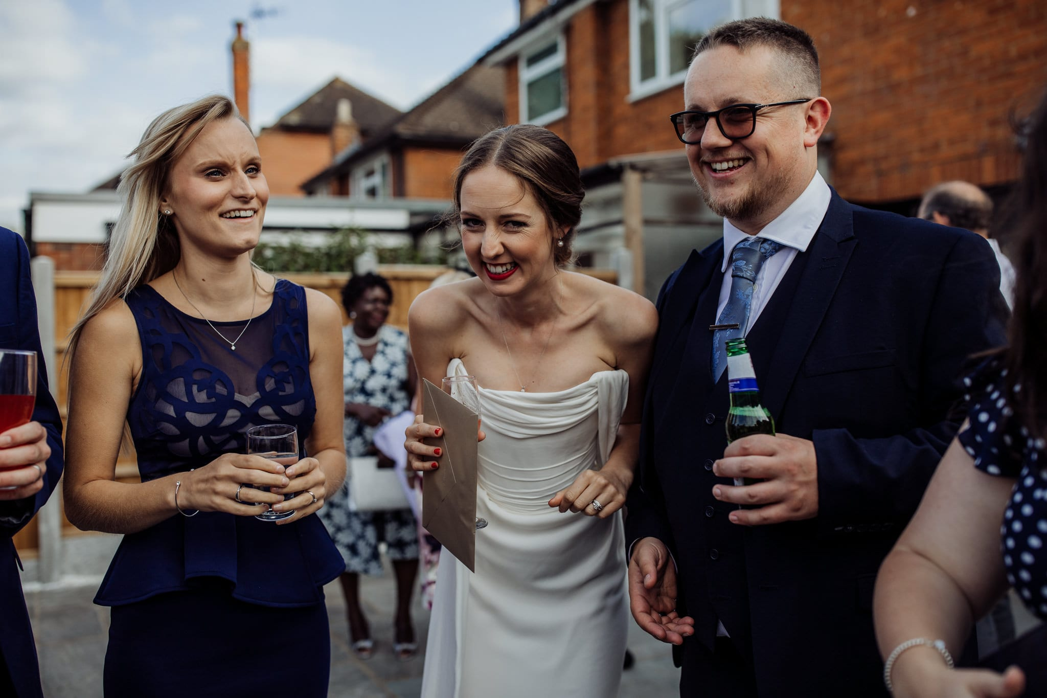 bride and guests laughing at an Essex back garden wedding
