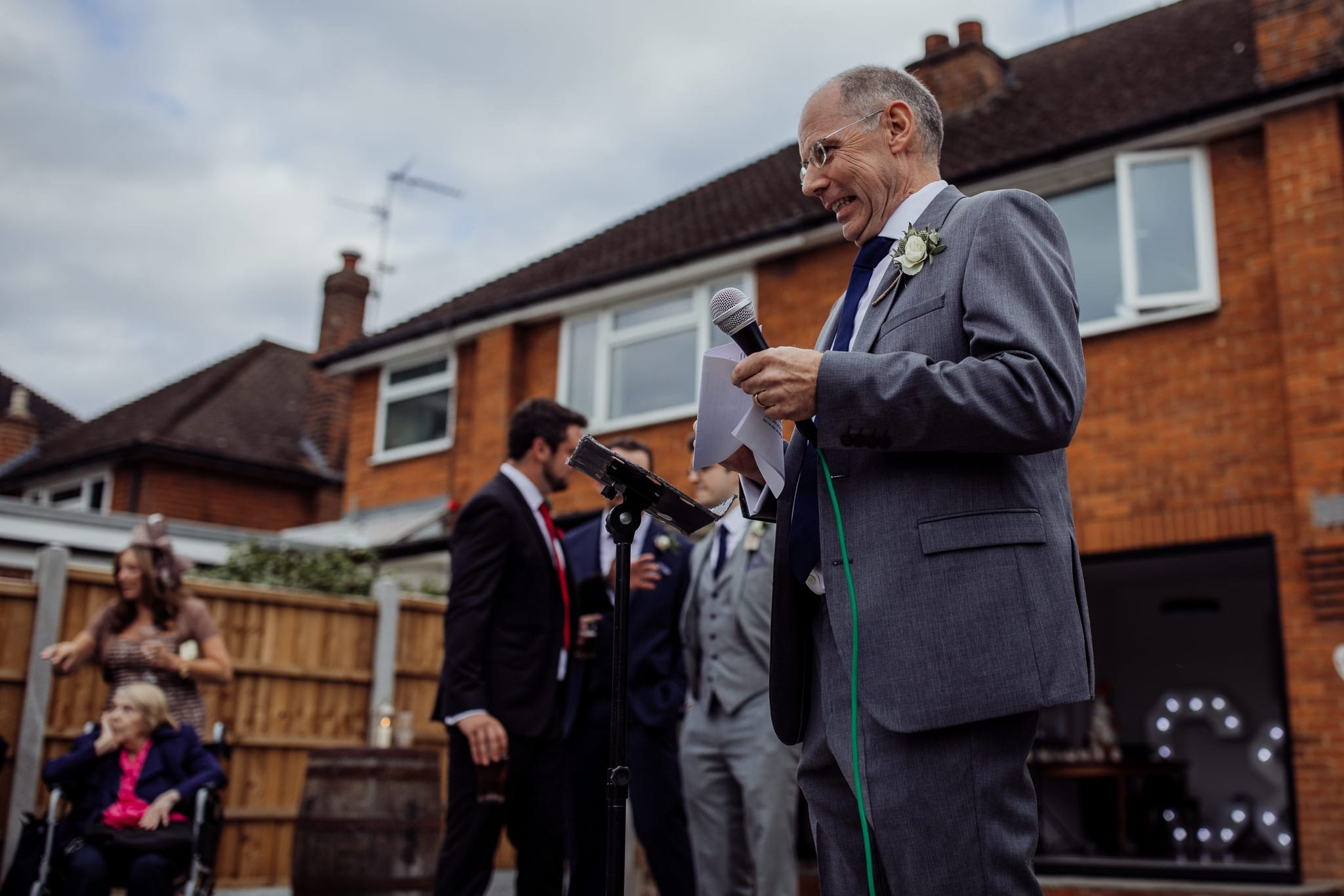 man holding microphone at an Essex back garden wedding