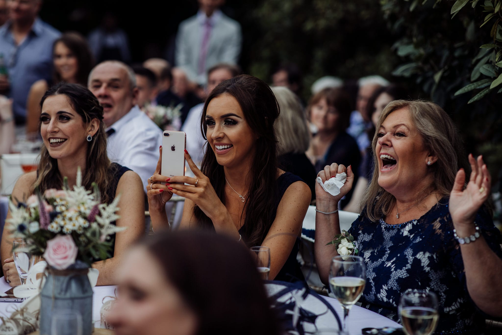 women laughing at an Essex back garden wedding