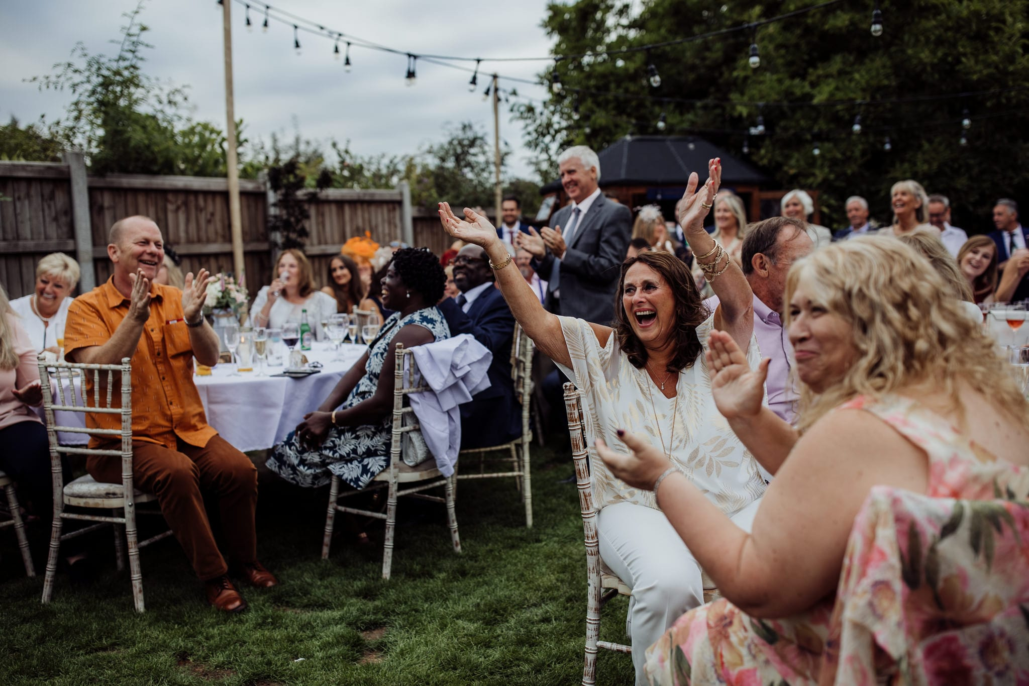 crowd cheering at an Essex back garden wedding