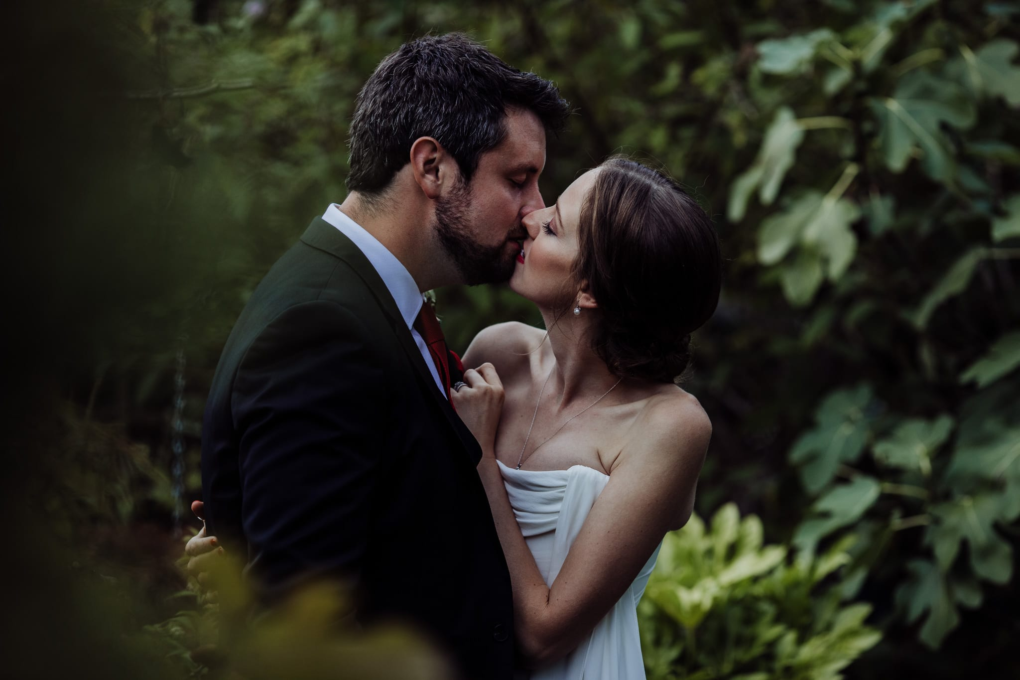 bride and groom almost kissing