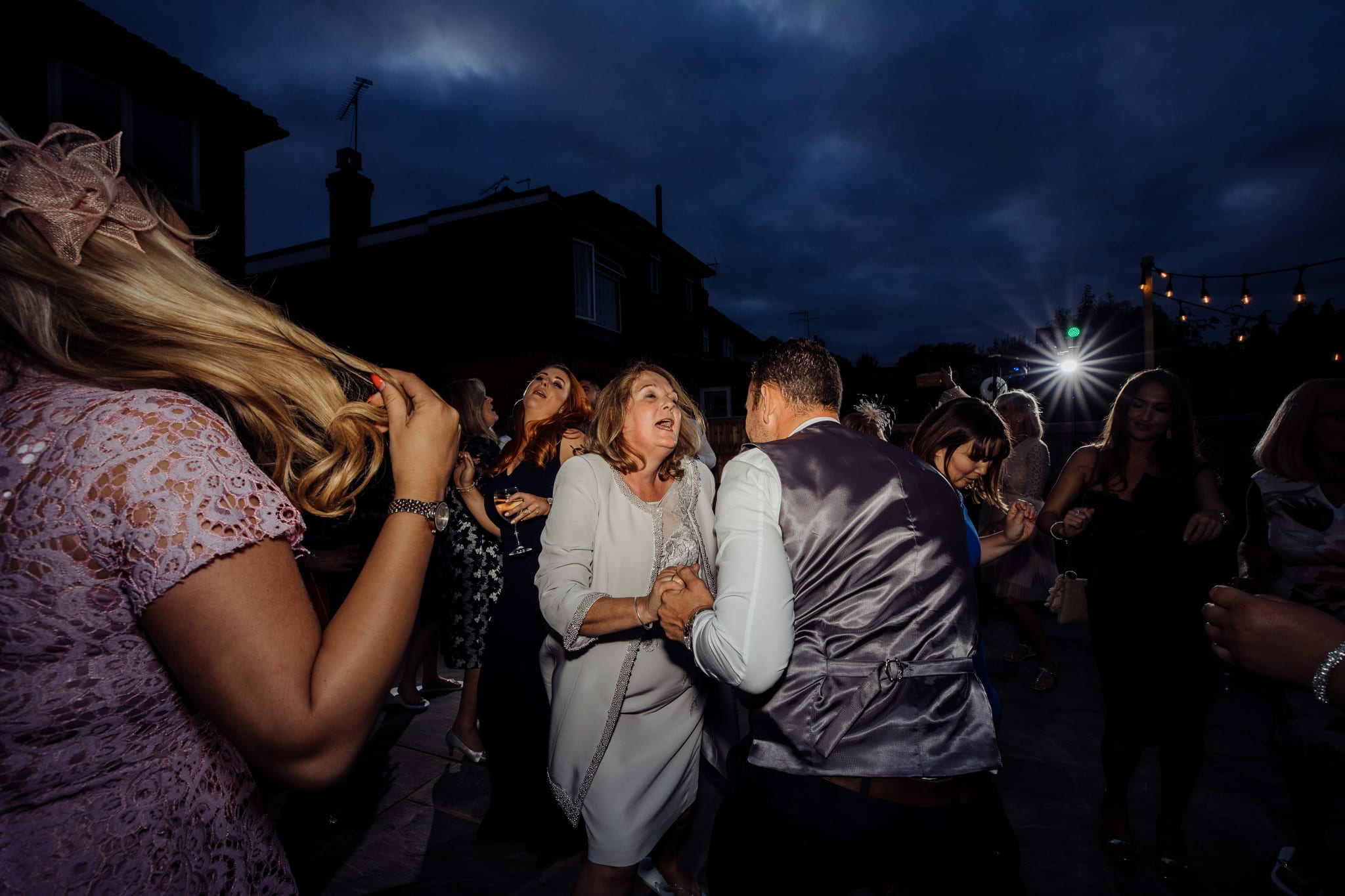 group of people dancing at an Essex back garden wedding