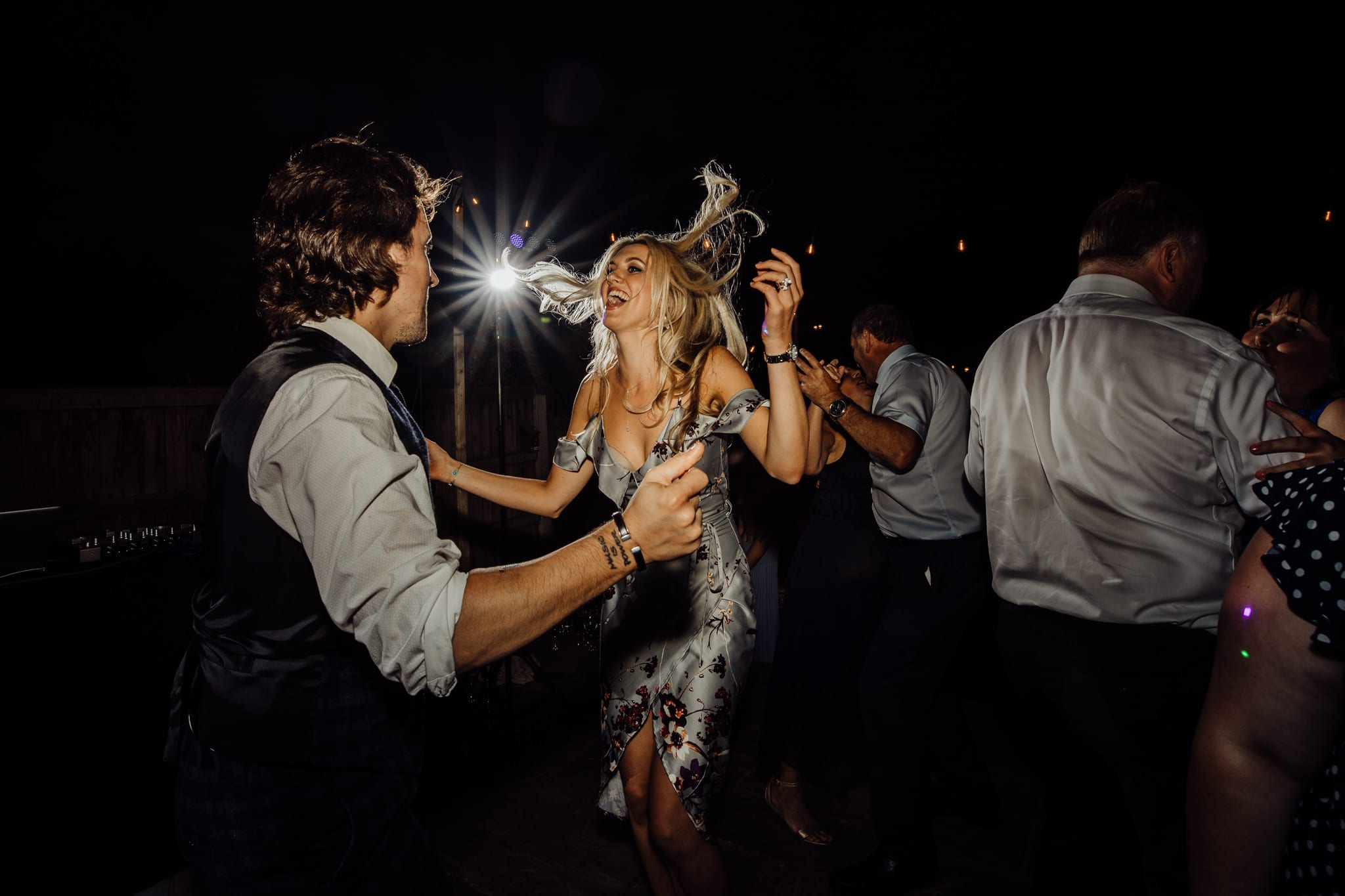wedding guest dancing with her hair flying