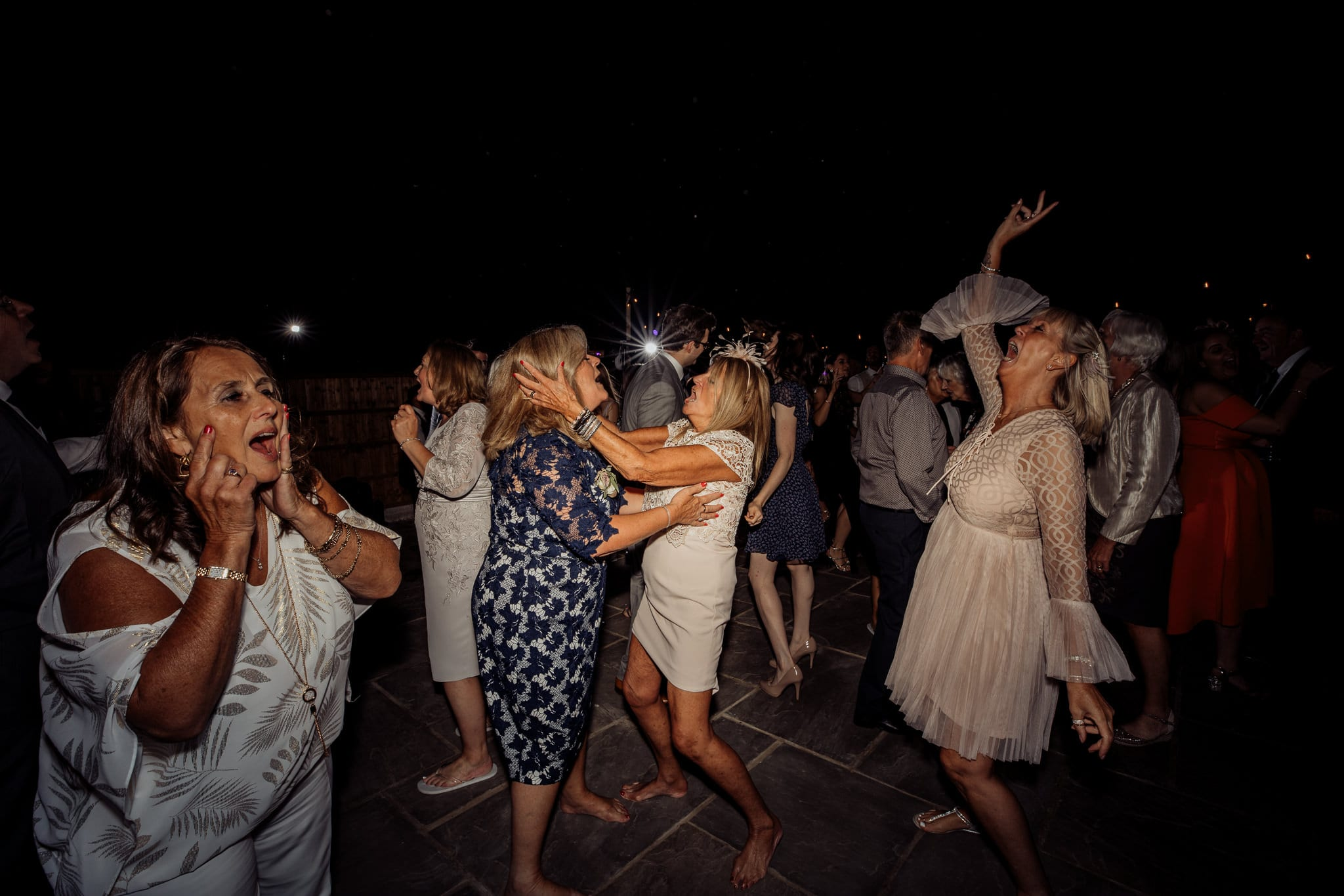 women partying at a back garden wedding in Essex