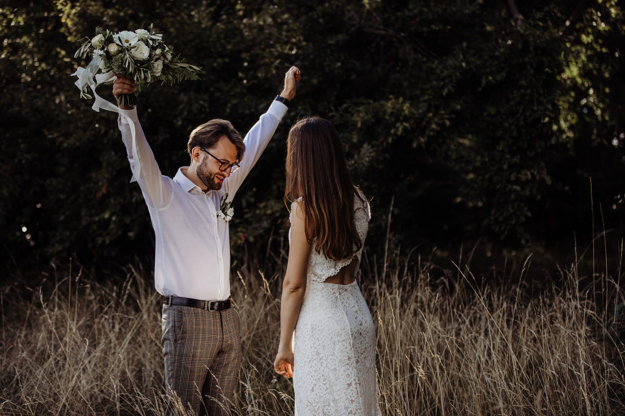 groom looking happy at Cambridge countryside elopement