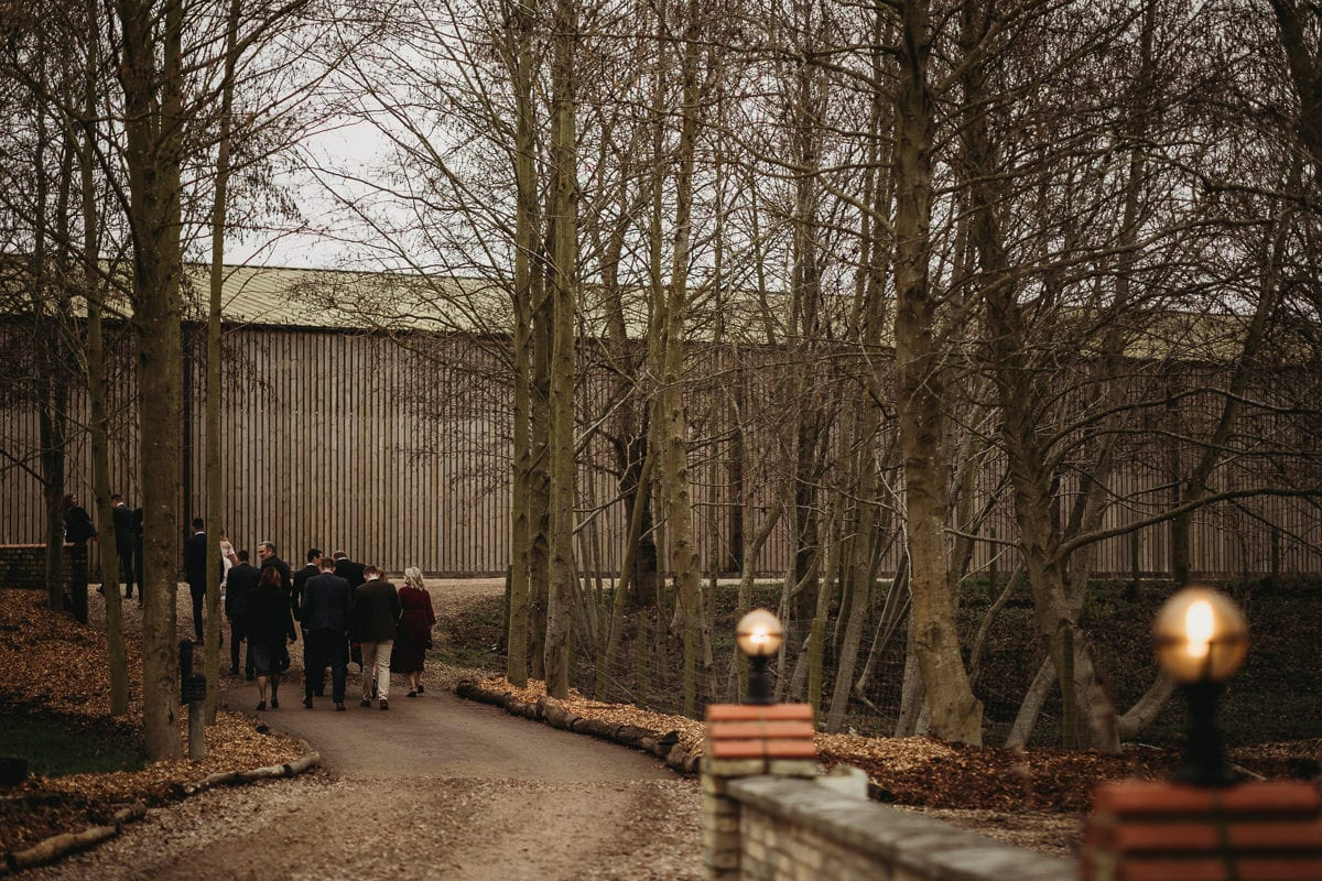 People walking towards a barn