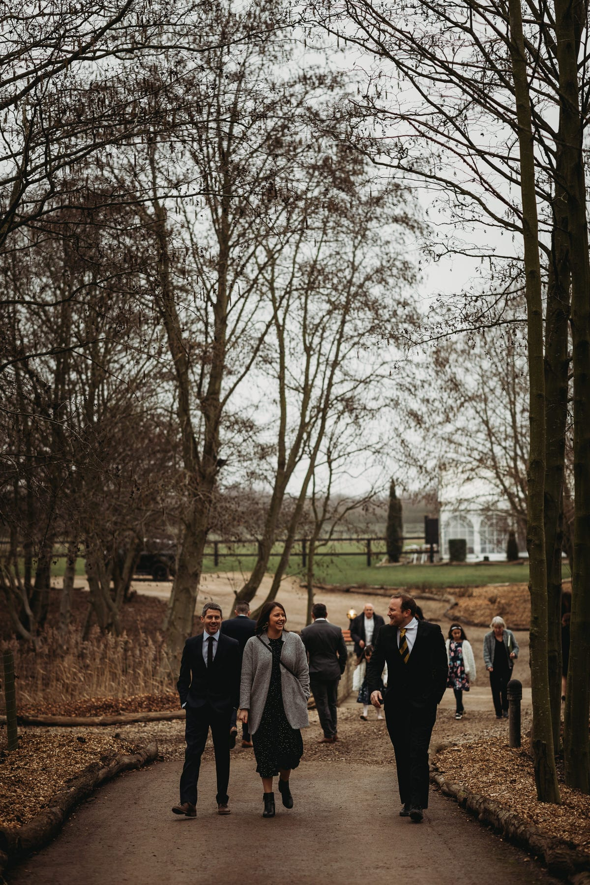 Guests walking in a woodland area