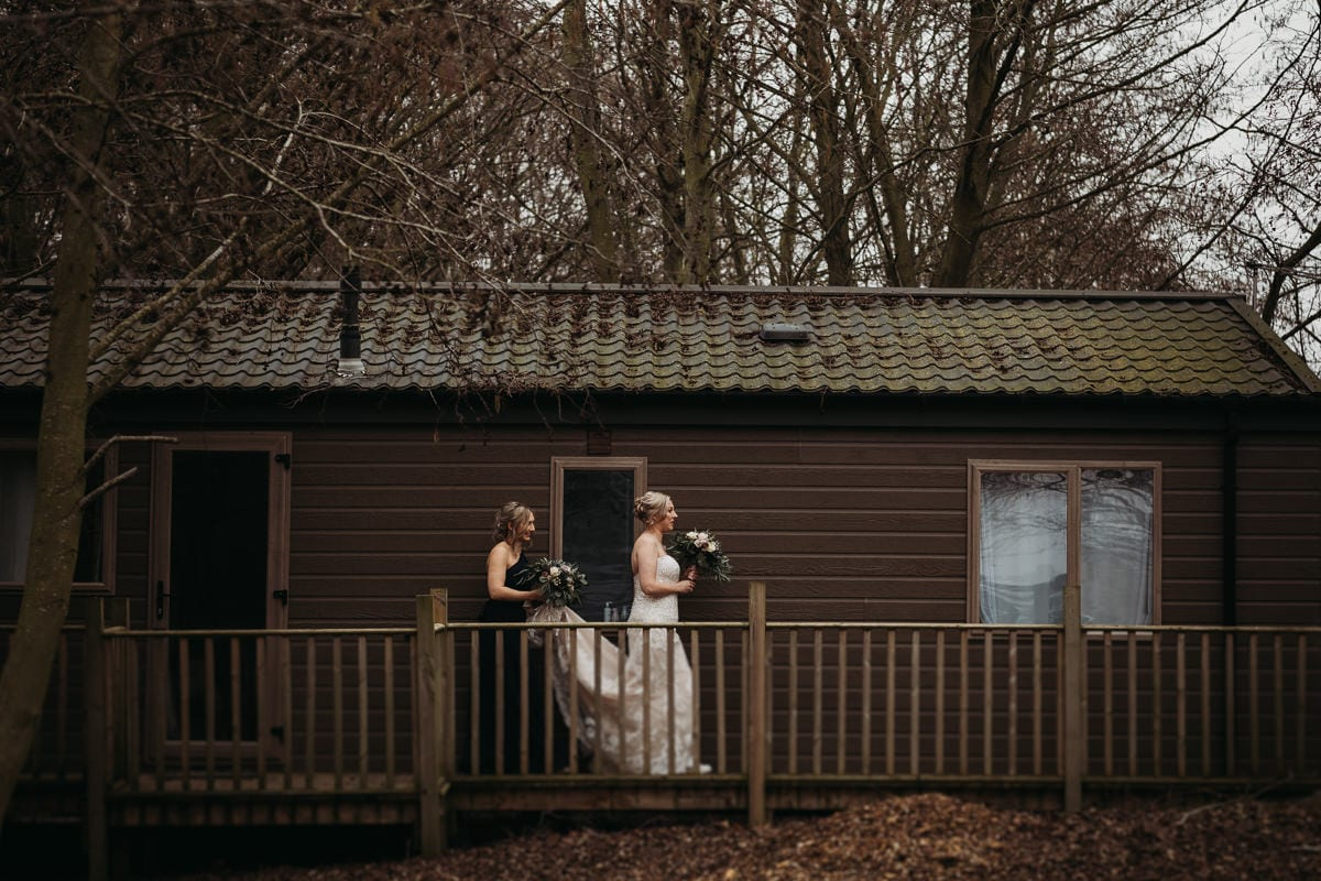 Bride and bridesmaid leaving the lodge