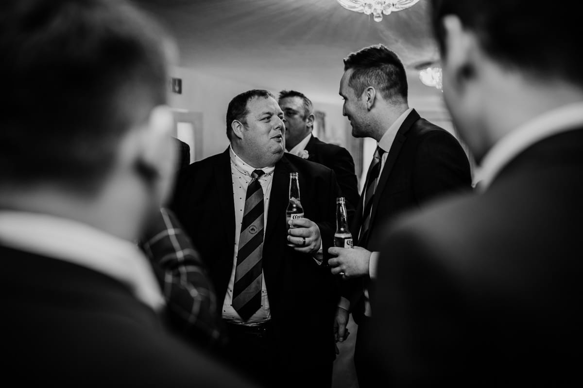 men talking and holding beer