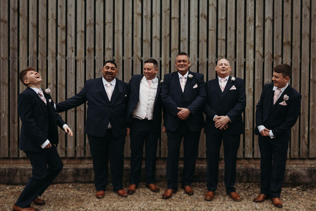 groomsmen group photo, young boy laughing