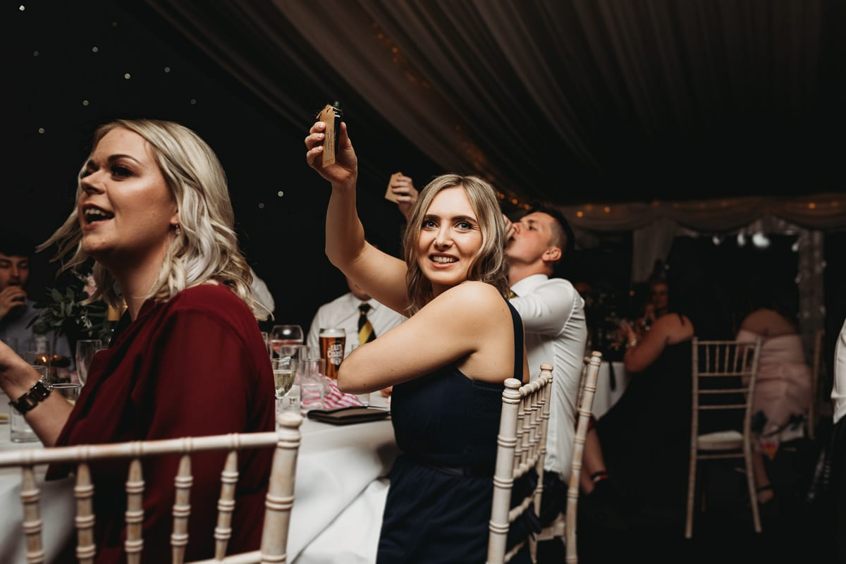 bridesmaid raising drink