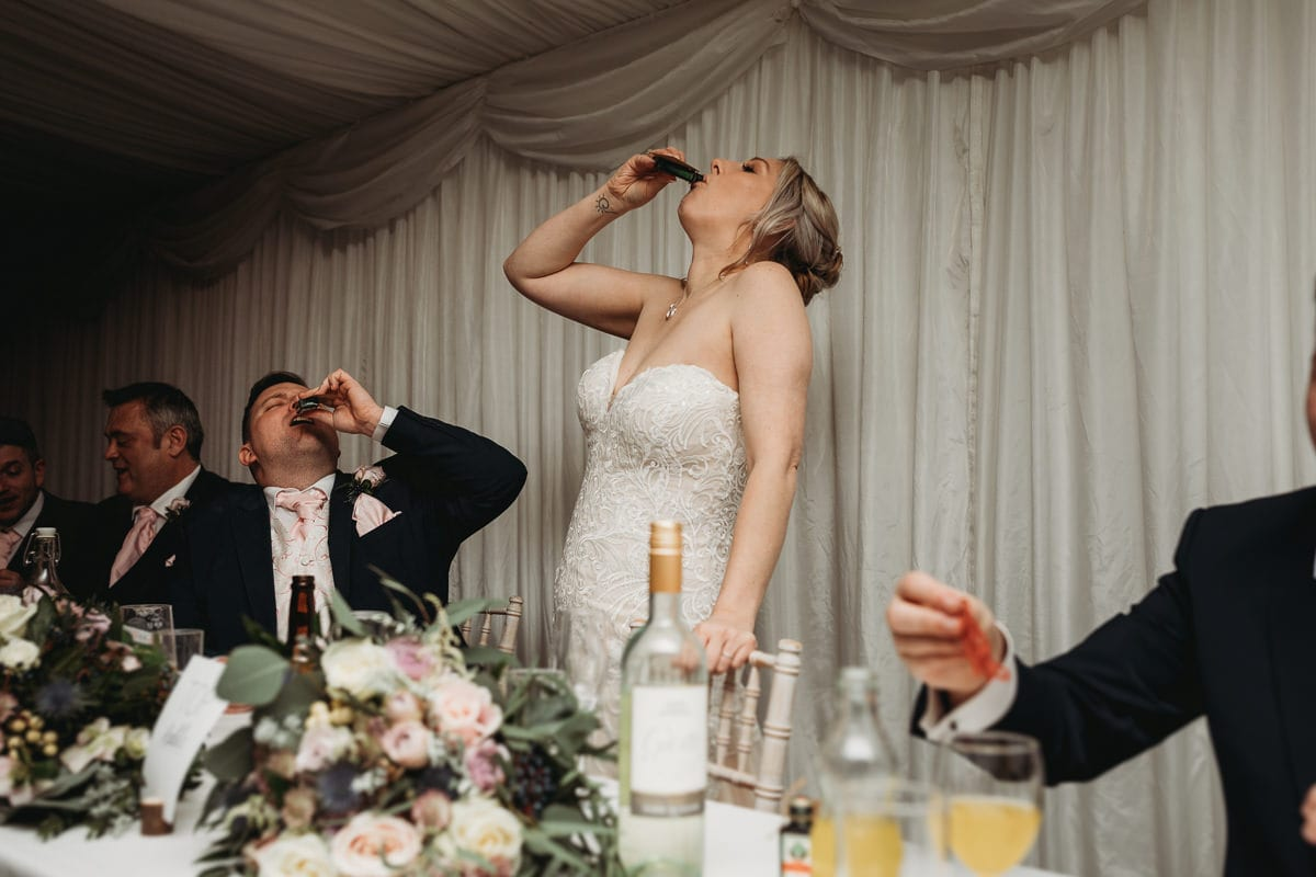 bride and groom drinking shots