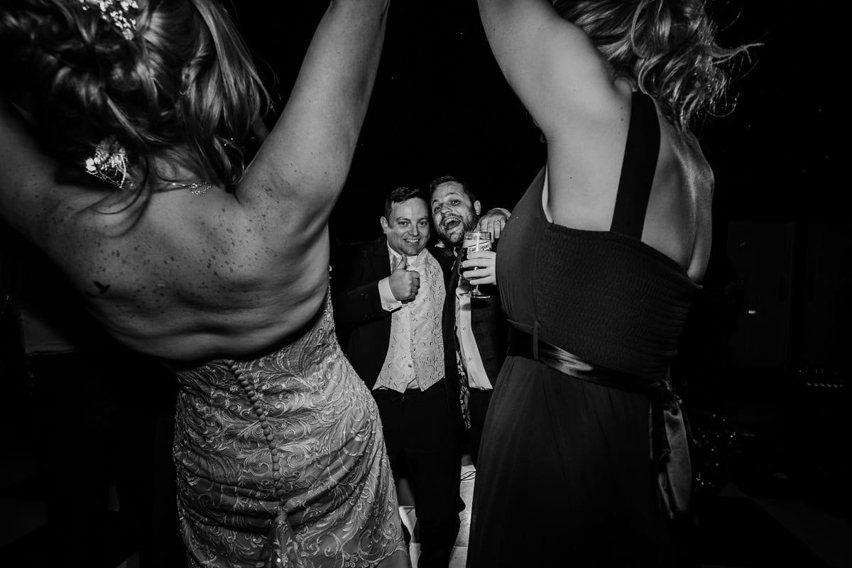groom and friend on the dancefloor