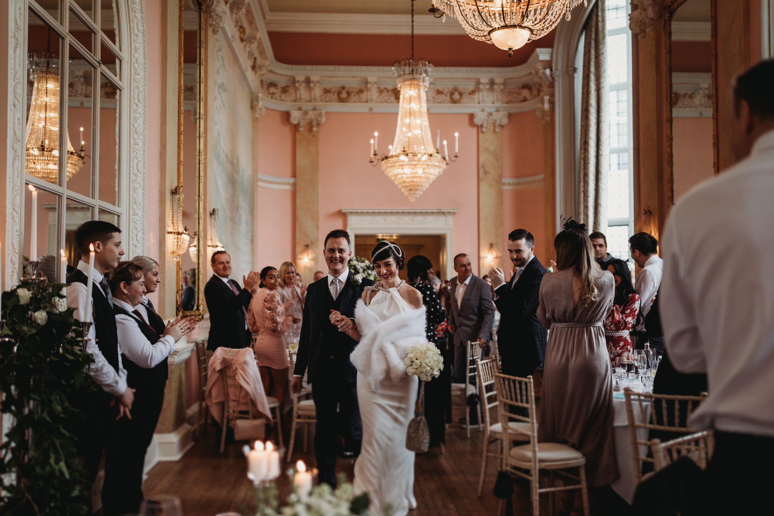 bride and groom enters the breakfast room at their Danesfield House wedding