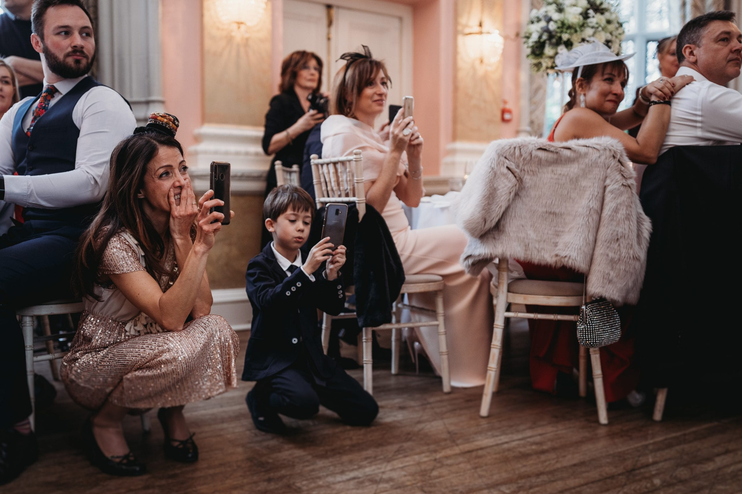 guests taking photos on a Danesfield House wedding