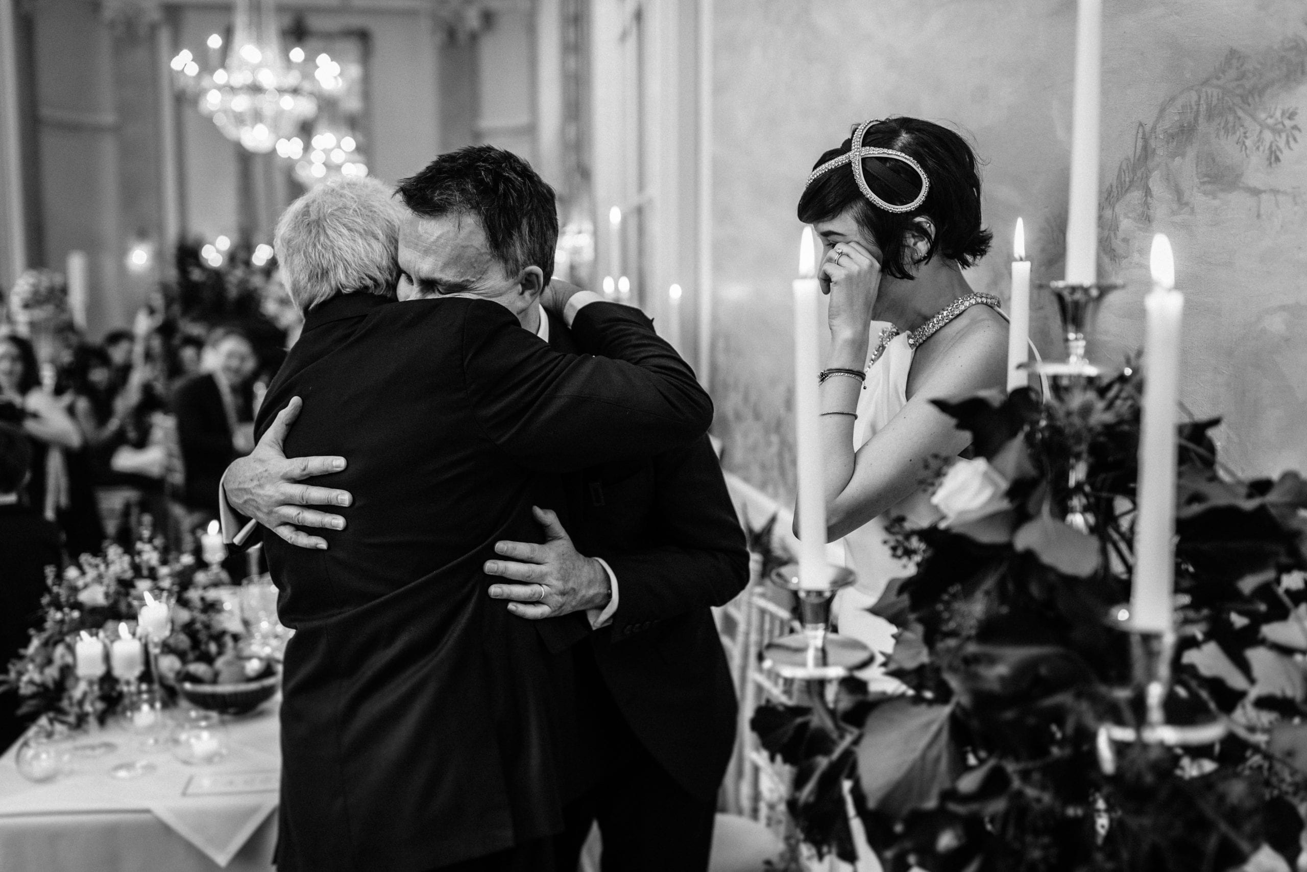 groom hugging bride's father