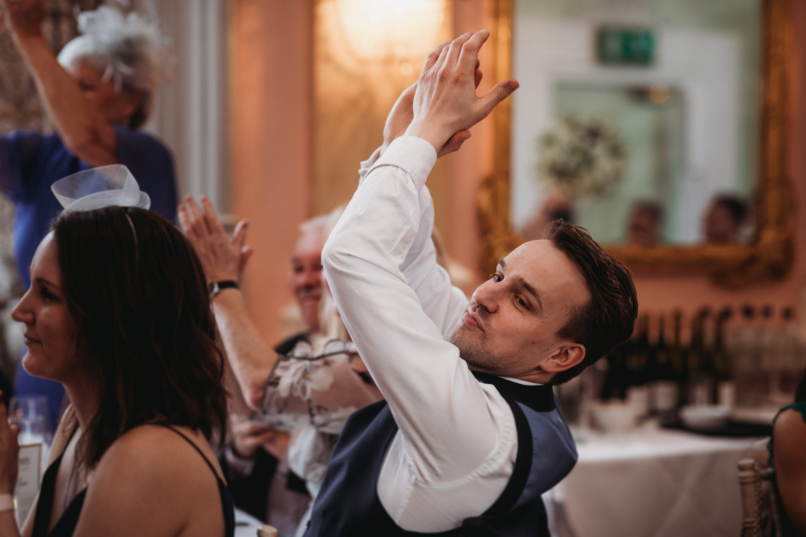 guest clapping at a Danesfield House wedding