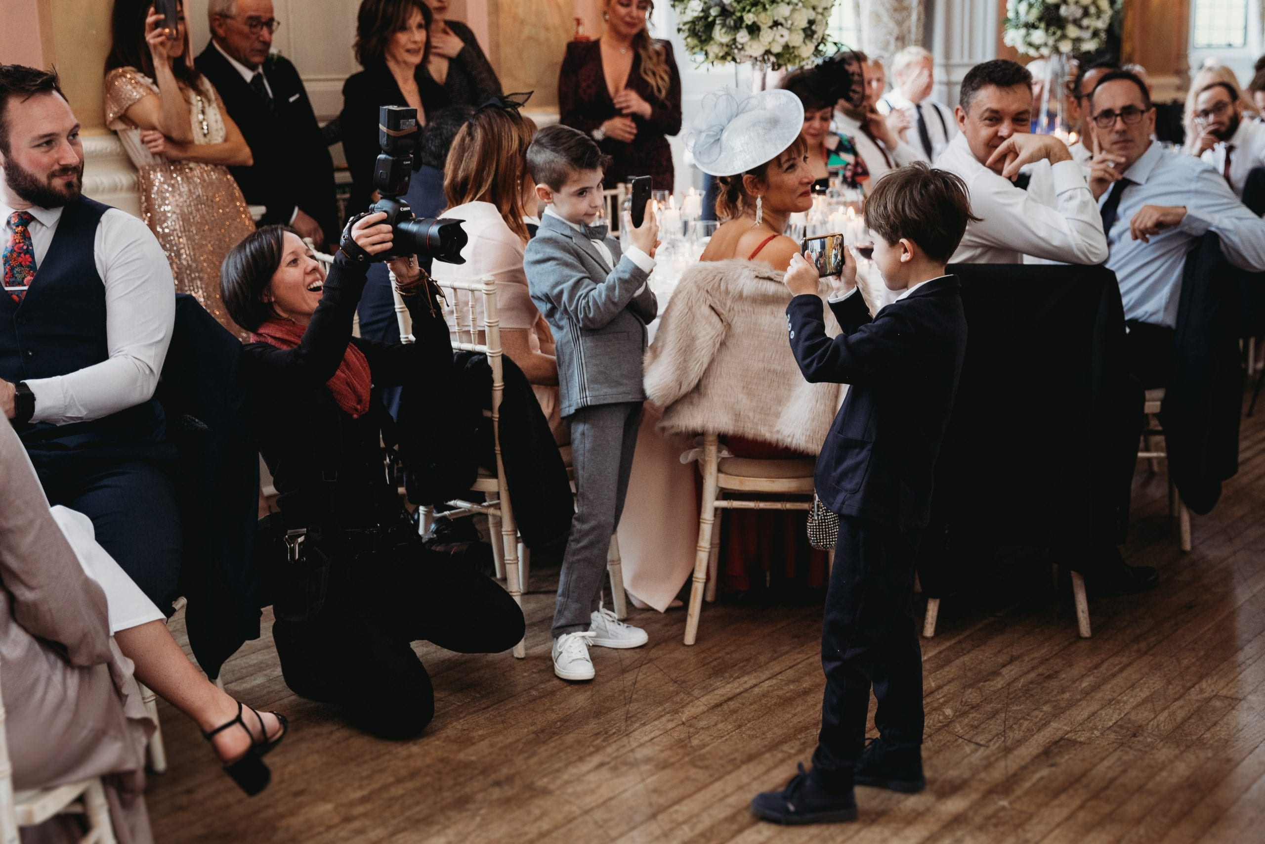 boy taking photo of photographer at a Danesfield House wedding