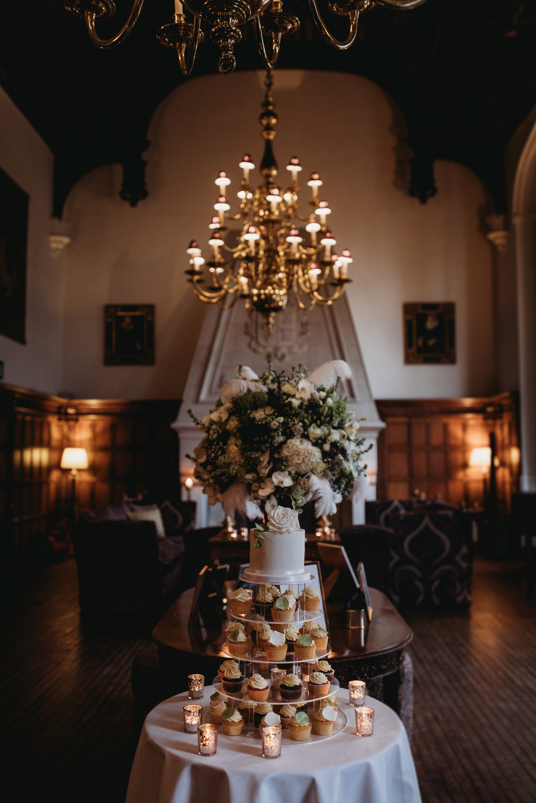 candles and wedding cake at a Danesfield House wedding