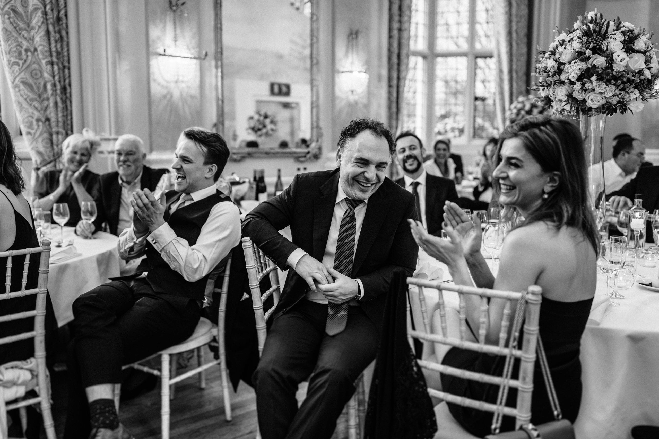 wedding guests laughing at a Danesfield House wedding
