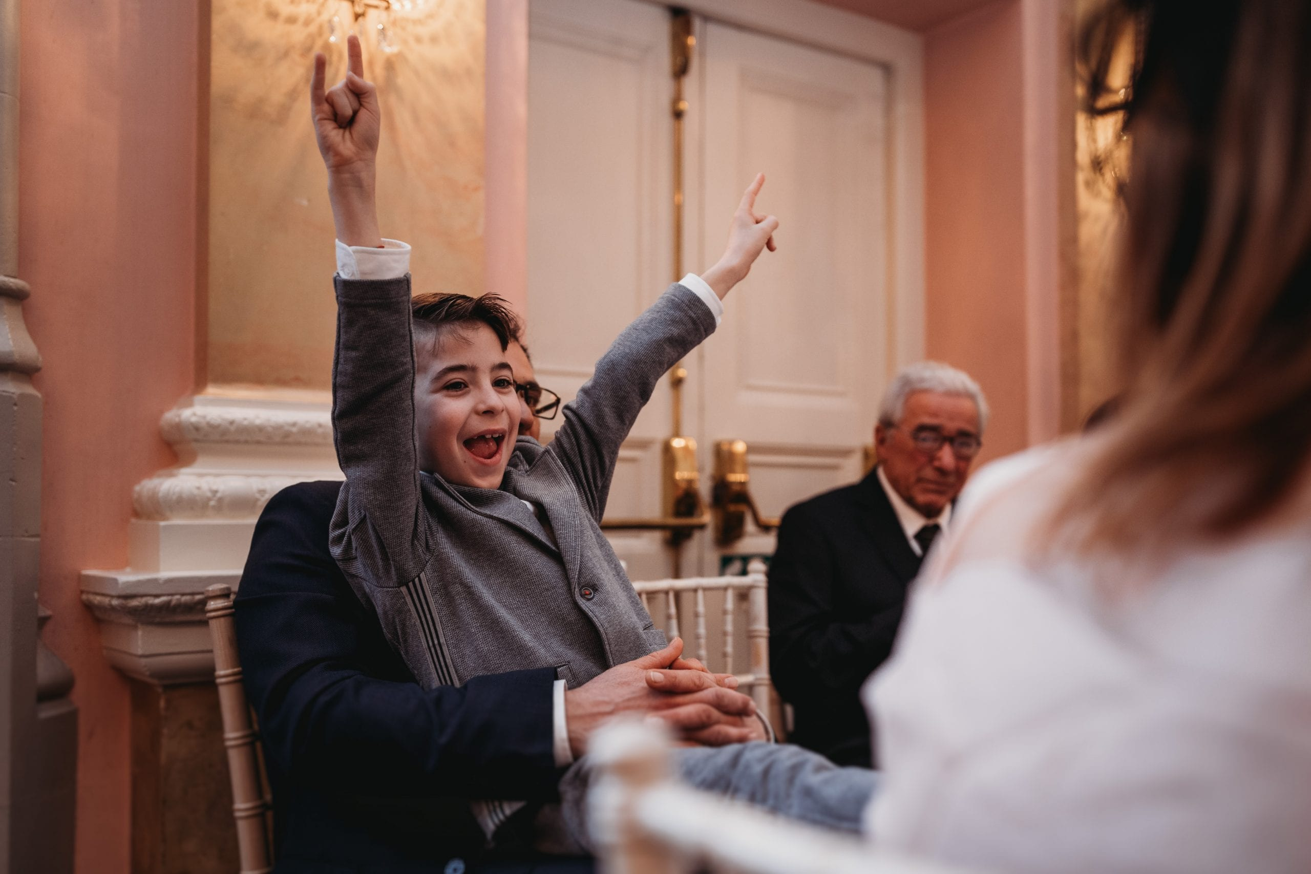 boy cheering at a Danesfield House wedding